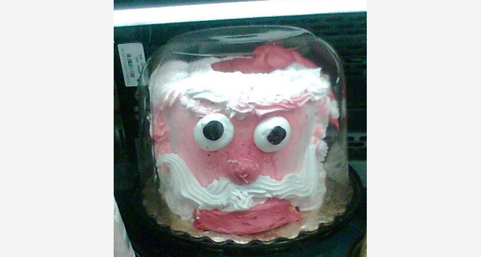 This cake Santa is in a glass case of emotion, and he is NOT OK. (Photo: Cake Wrecks)