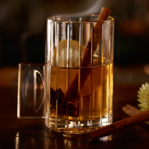 Rusty Apple Toddy. This fruity twist on the classic Hot Toddy is an ideal way to end your Christmas celebration. The drink includes herbal Scotch-based liqueur Drambuie, hot apple juice, lemon, and a cinnamon stick. It's so good, it may just end up as your nightcap for the whole winter.