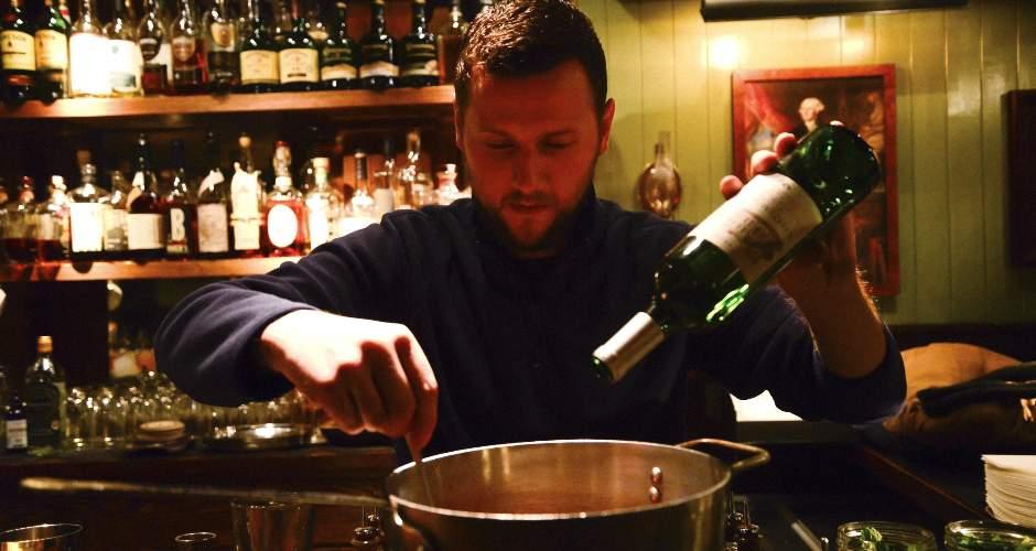 Pour the bottle of Bordeaux into the pan.