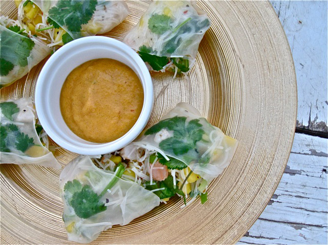 """Cambodian-Style Spring Rolls. The shrimp are poached in a flavorful broth that includes the mango peel. Then the cooked shrimp, as well as the fruit of the mango itself, go into a bright filling that is spooned into rice paper wrappers. A fruit and a """"fruit of the sea,"""" together at last."""