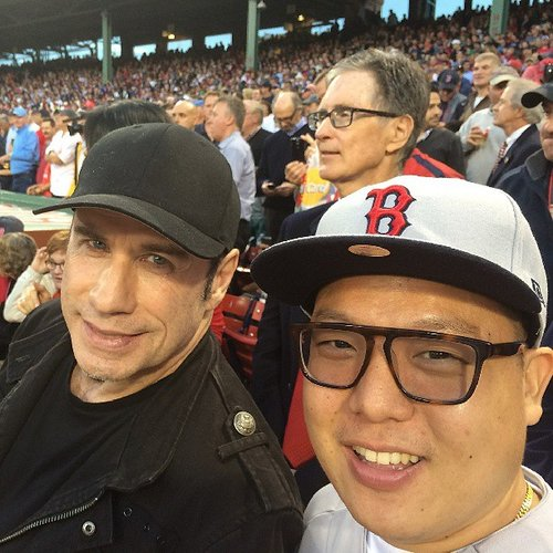"The Baus Eddie Huang snaps a selfie of himself with a man he refers to as ""#thegodtravolta."" (Photo:"