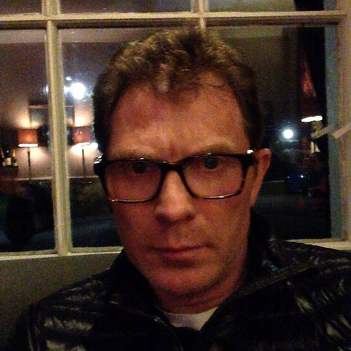 If you were already thinking about buying yourself some thick-frammed hipster specs this holiday season, here's the only incentive you need: Bobby Flay wearing them with utmost confidence. (Photo: