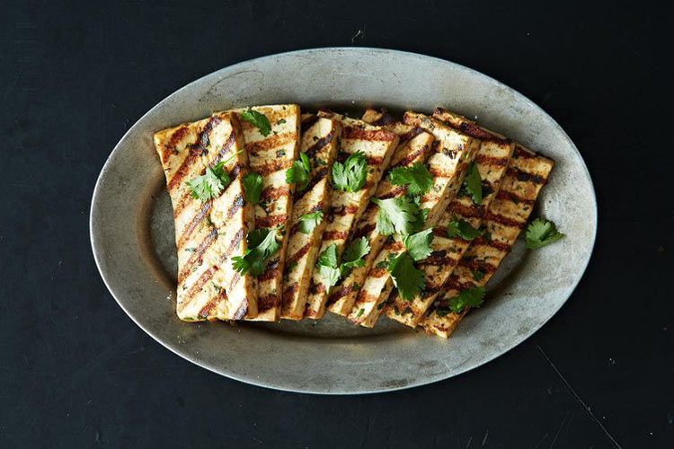 Grilled Peanut Tofu. This tofu, marinated in a slightly spicy peanut sauce, is a cinch to make and pleases just about everyone who sits down to a plate. It's easiest to make the marinade in the food processor, but mixing it up by hand won't give you any trouble.