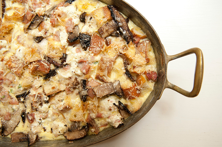 Savory Bread Pudding. Prosciutto, goat cheese, parmesan, sliced mushrooms, and copious amounts of fresh thyme make for a rich, custardy bread pudding with plenty of depth. Just think of this as strata gone wild.