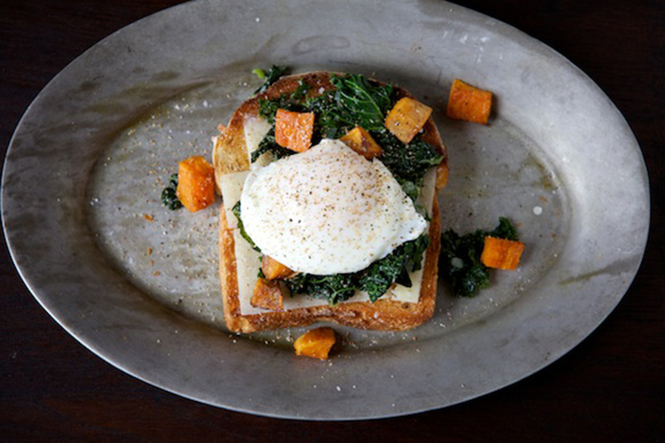 Sauteed Kale, Roasted Sweet Potato, and Poached Egg Toast. Chunks of sweet potato roasted in a little maple syrup, and kale wilted with onion and shallot make a nest for a soft poached egg, and all of this perches atop a chunky slice of toast layered with tangy pecorino. When you cut into the egg, the yolk becomes a silky sauce for all of the other elements.