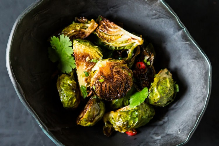 Momofuku's Roasted Brussels Sprouts with Fish Sauce Vinaigrette. This recipe, courtesy of New York City's renowned Momofuku, will add much-needed spark to your winter diet. Brussels sprouts get oven roasted, deep fried, and then tossed in a homemade vinaigrette with all the flavors of fish sauce, white wine vinegar, and a kick of red chile.