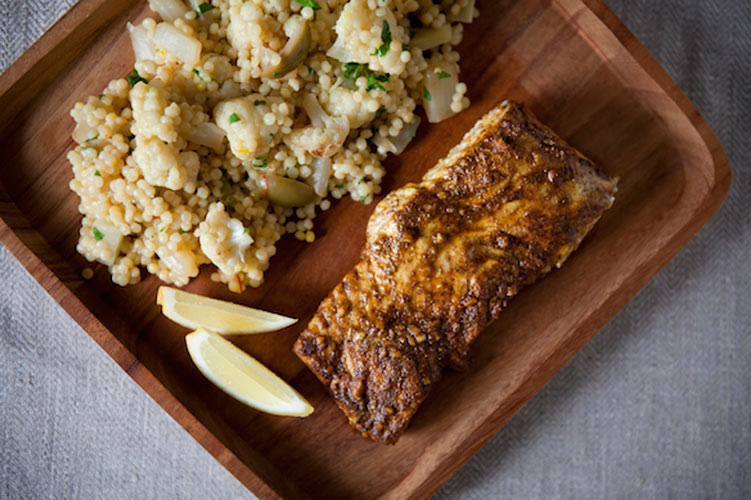 Saffron-Scented Vegetable Couscous with North African-Spiced Halibut. Marinating the halibut with olive oil, lemon juice, and a medley of spices results in an intensely flavored, warmly-spiced fillet.