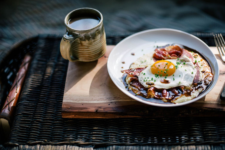 Goat Cheese Grits with Red Eye Gravy, Country Ham, and a Fried Egg.  The creamy, slightly sweet, tangy grits along with salty ham, coffee gravy, and the ever-perfect sunny side up egg result in the quintessential southern breakfast (or dinner).