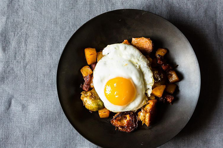 Brussels Sprout and Chorizo Beer Hash. What's not to love about a dish that brings together salty, spicy chorizo, caramelized Brussels sprout, potato hash, a refreshing lager, and velvety, runny eggs?