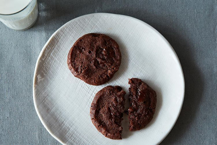 Pierre Herme and Dorie Greenspan's World Peace Cookies. Fine and sandy, but with a friendly, soft chew, these cookies are made of well-salted, well-buttered cocoa dough, with generous pockets and wisps of chocolate feeding through. One bite is all the proof you need that they live up to their name.