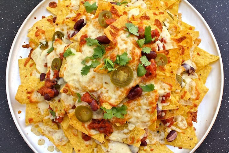 Nachos: inspiring in more ways than you even knew. (Photo: First We Feast)