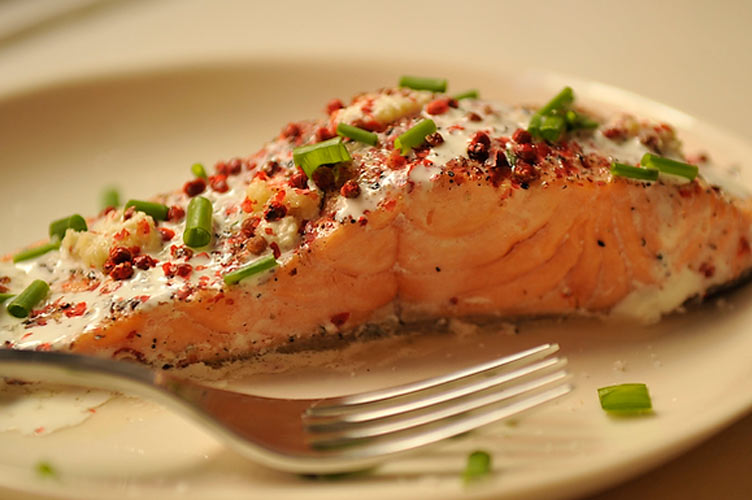 Salmon Papillotes with Red Peppercorns, Lime, and Fresh Ginger. Ginger and red peppercorns add a welcome heat, and lime juice and dill keep it fresh. A spoonful of thick cream over each gently-cooked fillet melds the flavors.