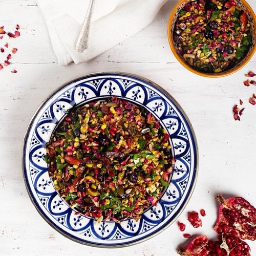 Colorful Moroccan salad of rose petals, pomegranate, and pistachios. Photo: