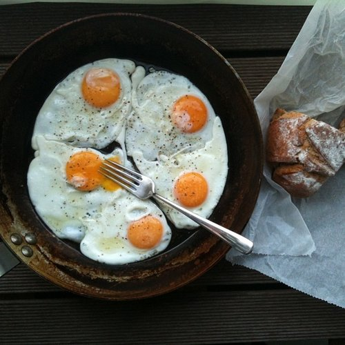 Five golden yolk eggs and some crusty bread for breakfast; keep it simple. Photo: