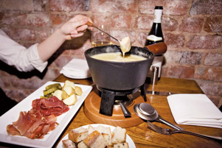 Swiss fondue with fixings at Trestle on Tenth (Photo: