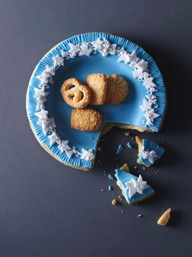 "A Wedgewood plate made of shortbread, blue fondant, and white royal icing. This piece was one of the trickiest to create. ""I really wanted the plate to look like a plate, so I experimented with the shortbread by baking it on different plates. Too much butter and the shortbread would break, too thin and it would catch on the edges of the plate and break when I iced it. In the end I succeeded with a totally edible plate,"" artist Kim Morphew tells Slate."
