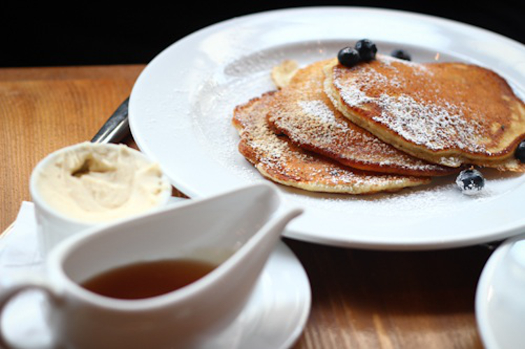 Buttermilk pancakes with blueberries at Plein Sud  (Photo: Serious Eats)