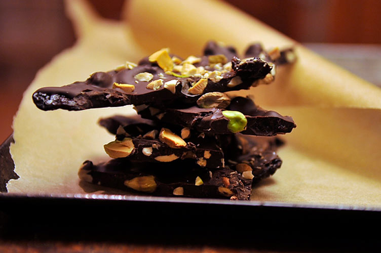 Ancho Chili-Cinnamon Chocolate Bark. This decadent dark chocolate bark is spiced with smoky ancho, cinnamon, cloves, and black pepper, then studded with dried cherries, cashews, and pistachios.