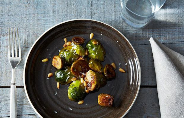 Brussels Sprouts with Pine Nuts and Thyme. Cooking the Brussels sprouts in white wine allows them to be steamed and evenly cooked to a perfect al dente. A sprig of thyme, a handful of pine nuts, and a sprinkling of Parmesan are the perfect complement.