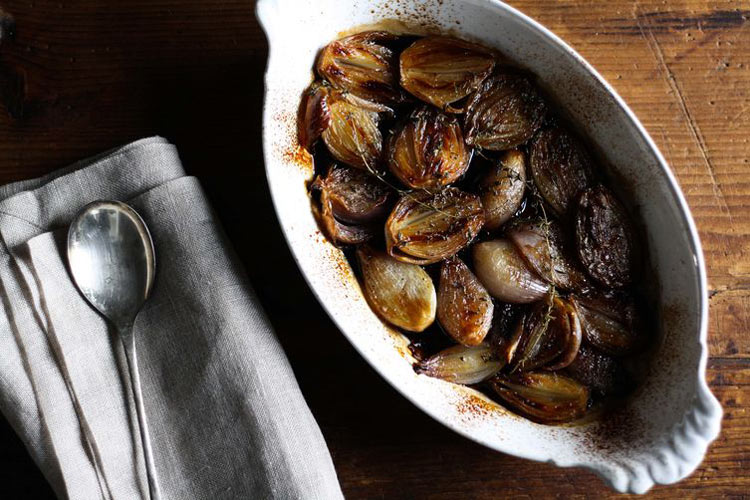 Balsamic Roasted Shallots. Shallots become dark, sticky, and tender when roasted with plenty of balsamic, sherry, and thyme.