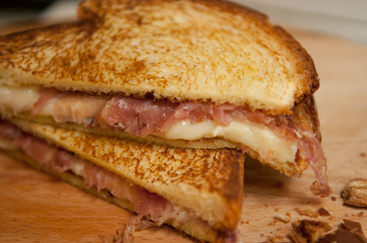 Brie and Prosciutto Melt. Buttery brioche with oozing melted brie and salty prosciutto sandwiched in between is so necessary.