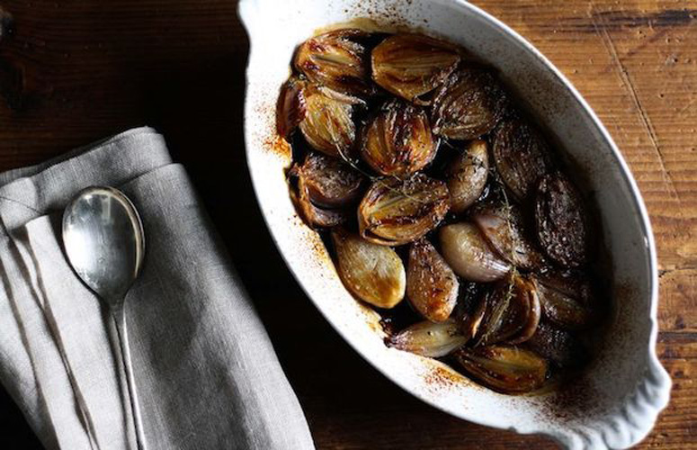 Balsamic-Roasted Shallots. Sear shallots until they develop a beautiful, brown crust, add salt, thyme, sherry, and balsamic vinegar, then roast them until they are dark, sticky, and tender.