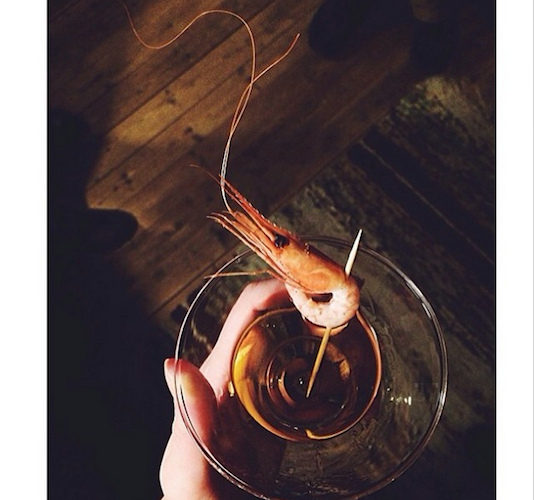 This Aquavit martini with a northern shrimp just may be the most picturesque cocktail we've seen in a while. Photo: @bonappetitmag