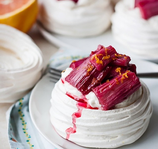 These stunning meringue cups are piled high with zesty roasted rhubarb and vanilla bean whipped cream. Photo: @bloggingoverthyme