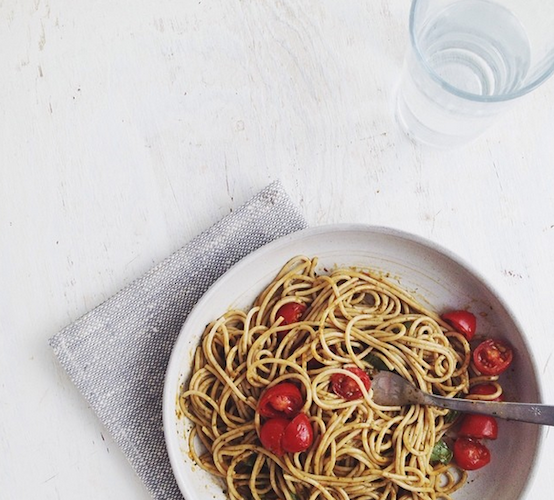 Whole wheat pasta gets gussied up with spinach-basil-balsamic dressing and a sprinkling of cherry tomatoes. Photo: @sarah_kieffer