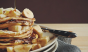 This stack of banana pancakes drizzled with maple syrup is what our breakfast dreams are made of. Photo: @janeamandasee