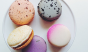 A colorful assortment of macarons. Flavors include earl gray, lavender, and honey ginger. Photo: @caye_nano