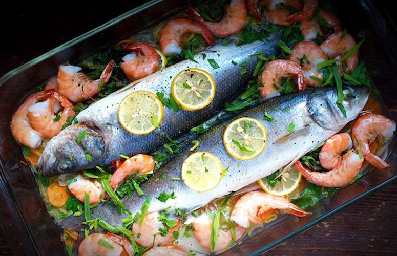Loup de Mer (Mediterranean Seabass). All you need to do is buy the most beautiful, fresh fish that you can, and this requires little adornment. A bed of shrimp, a few herbs, and some thinly sliced lemon are all you need to create a dish that is as showstopping as it is delicious.