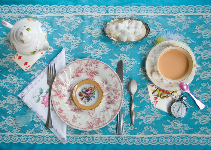 """Alice's Adventures in Wonderland by Lewis Carroll, 1865. """"'Have some wine,' the March Hare said in an encouraging tone. Alice looked all round the table, but there was nothing on it but tea."""""""
