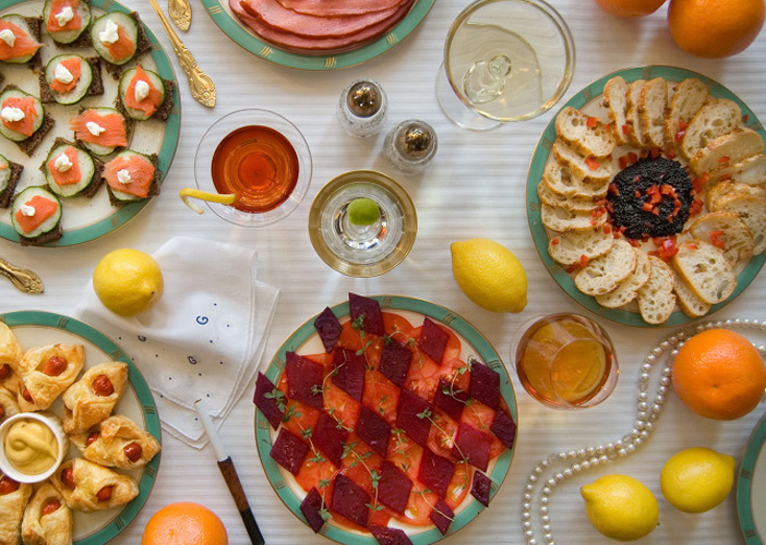 """The Great Gatsby by F. Scott Fitzgerald, 1925. """"On buffet tables, garnished with glistening hors-d'oeuvre, spiced baked hams crowded against salads of harlequin designs and pastry pigs and turkeys bewitched to a dark gold."""""""