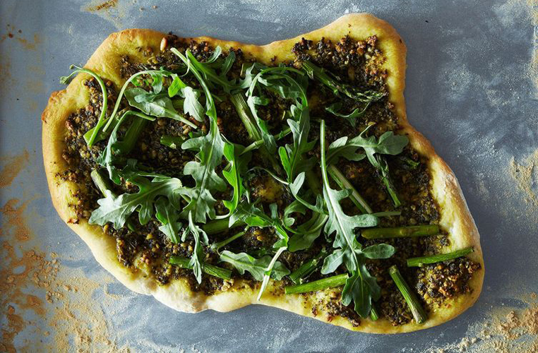Asparagus and Arugula Pizza with Vegan Pesto. Bursting with the flavors of zesty arugula, lemony basil, and grassy asparagus, this pizza's as fresh and light as can be and the epitome of a spring.