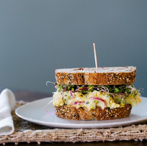 This egg salad sandwich swaps out mayo for Greek yogurt, and gets extra flavor from radishes and chives. Photo: @acouplecooks