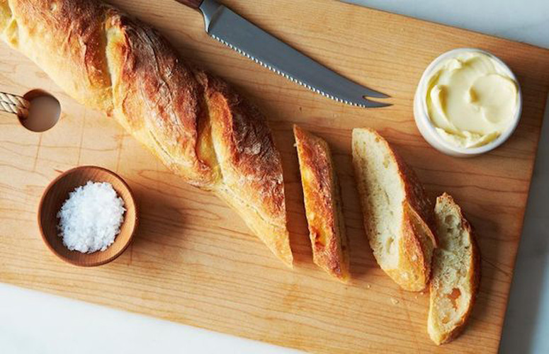 Dan Leader's 4-Hour Baguette. This recipe is the aggressive, no-more-excuses shove that you need to start baking your own bread. It will only take you 4 hours of intermittent attention, and won't require a starter nor any equipment you don't already own—and it will rival your favorite bakery's version.