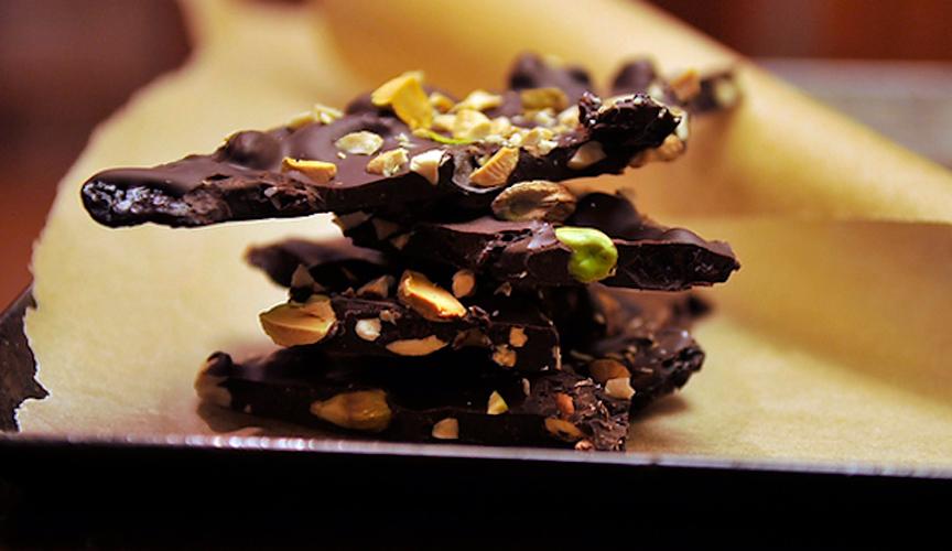 Ancho Chili-Cinnamon Chocolate Bark. Waves of smooth dark chocolate are spiced with smoky ancho, cinnamon, cloves and black pepper, and studded with dried cherries, cashews and pistachios.
