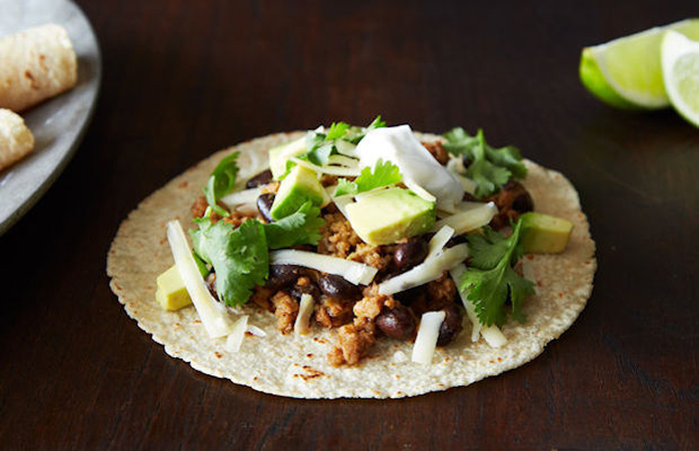 Coconut-Lime Pork Tacos with Black Beans and Avocado. The care that goes into flavoring these tacos is what makes them amazing. A serious, toasted spice blend gives them another dimension, and the lime and pineapple juices another still. We love tortillas, but we could eat this straight out the pan.