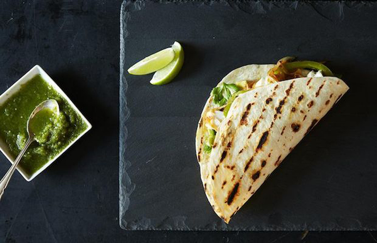Fish Tacos on the Grill. Nothing beats tender chunks of grilled white fish nestled in a soft, warm flour tortilla among strips of sweet onion and green pepper, creamy slices of avocado and a sprinkle of fresh cilantro. Don't forget lime wedges for spritzing, and plenty of homemade salsa.