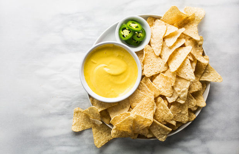 Nacho Cheese Sauce. Though they may look similar, this bears no resemblance to the gloppy, processed goo of concession stand nightmares. This sauce is velvety, spicy, and, above all, actually tastes like cheese.