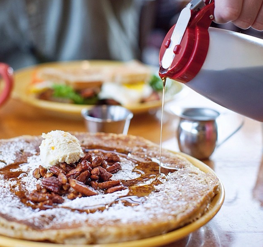 Tupelo Honey Cafe's famous sweet potato pancakes get the ultimate Southern topping of whipped peach butter and spiced pecans. Photo: @sliceofpai