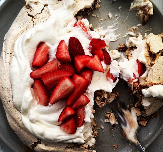 Brette Warshaw, the managing editor at Food52, shows us the right way to eat pavlova. Photo: @bstarwarshaw