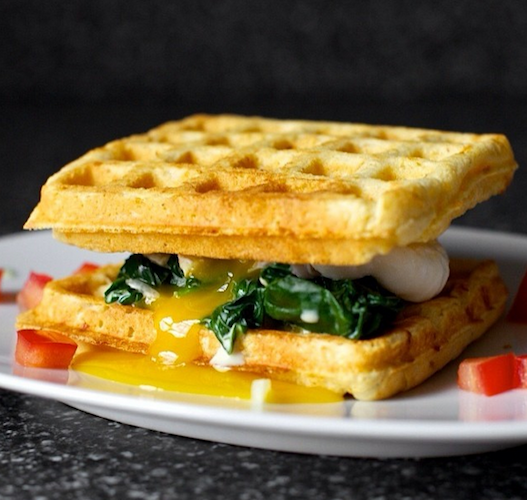 Deb Perelman from Smitten Kitchen steps up her brunch game with a cheddar cornbread waffle sandwich, stuffed with creamed greens and a poached egg. Photo: @smittenkitchen
