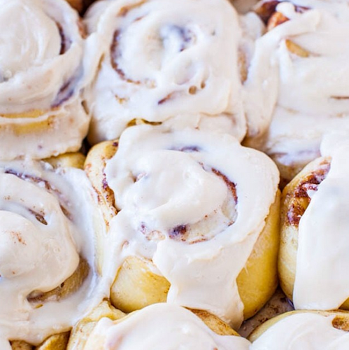 These cinnamon buns are almost completely obscured by frosting—just the way we like 'em. Photo: @averiesunshine
