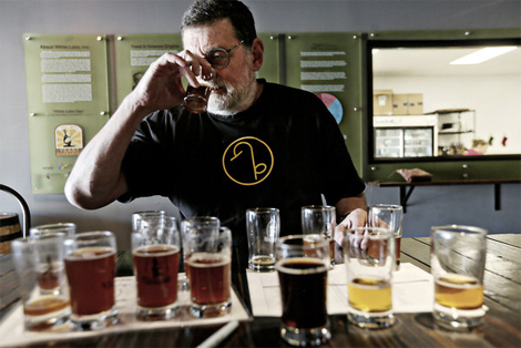 A brewer samples beers at San Diego's White Labs