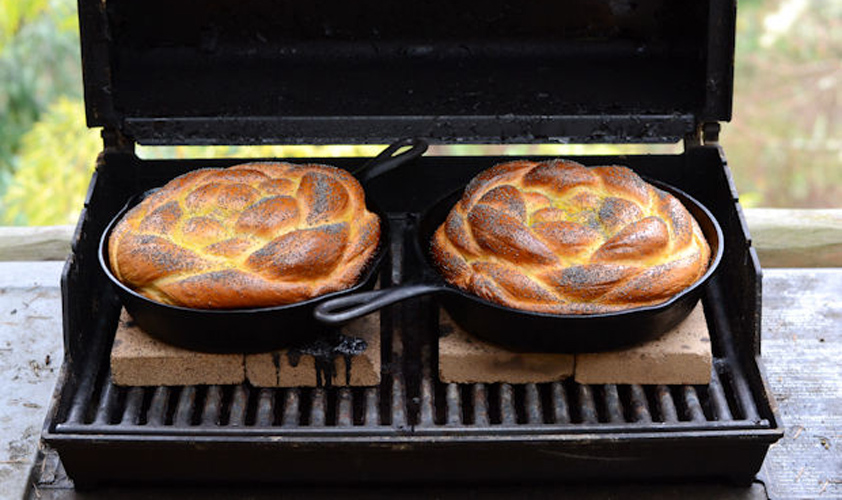 Challah Baked on the Grill. It's always fun to make your own, right? More than fun, this recipe for challah, baked on the grill, offers a back porch rendition of the traditionally oven baked. The braided dough of challah has never worn anything better than a cast-iron skillet.