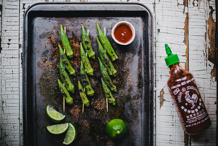 Grilled Okra with Sriracha Lime Salt.  A departure from fried okra, this grilled take on this quintessential Southern vegetable is sure to convert even the most skeptical okra doubter due to the addition of Sriracha in salt form.