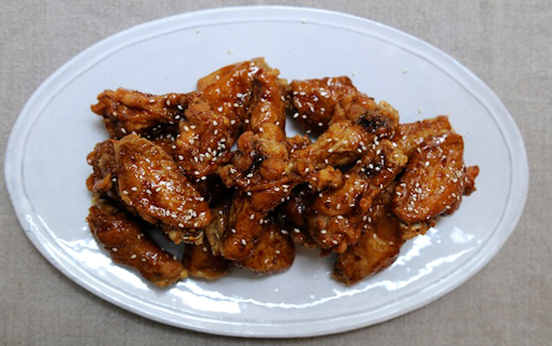 KFC: Korean Fried Chicken Wings. Honeyed and fragrant with a fiery kick, these chicken wings are totally addictive.