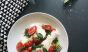 Nothing says summer quite like a simple Caprese salad. Photo: